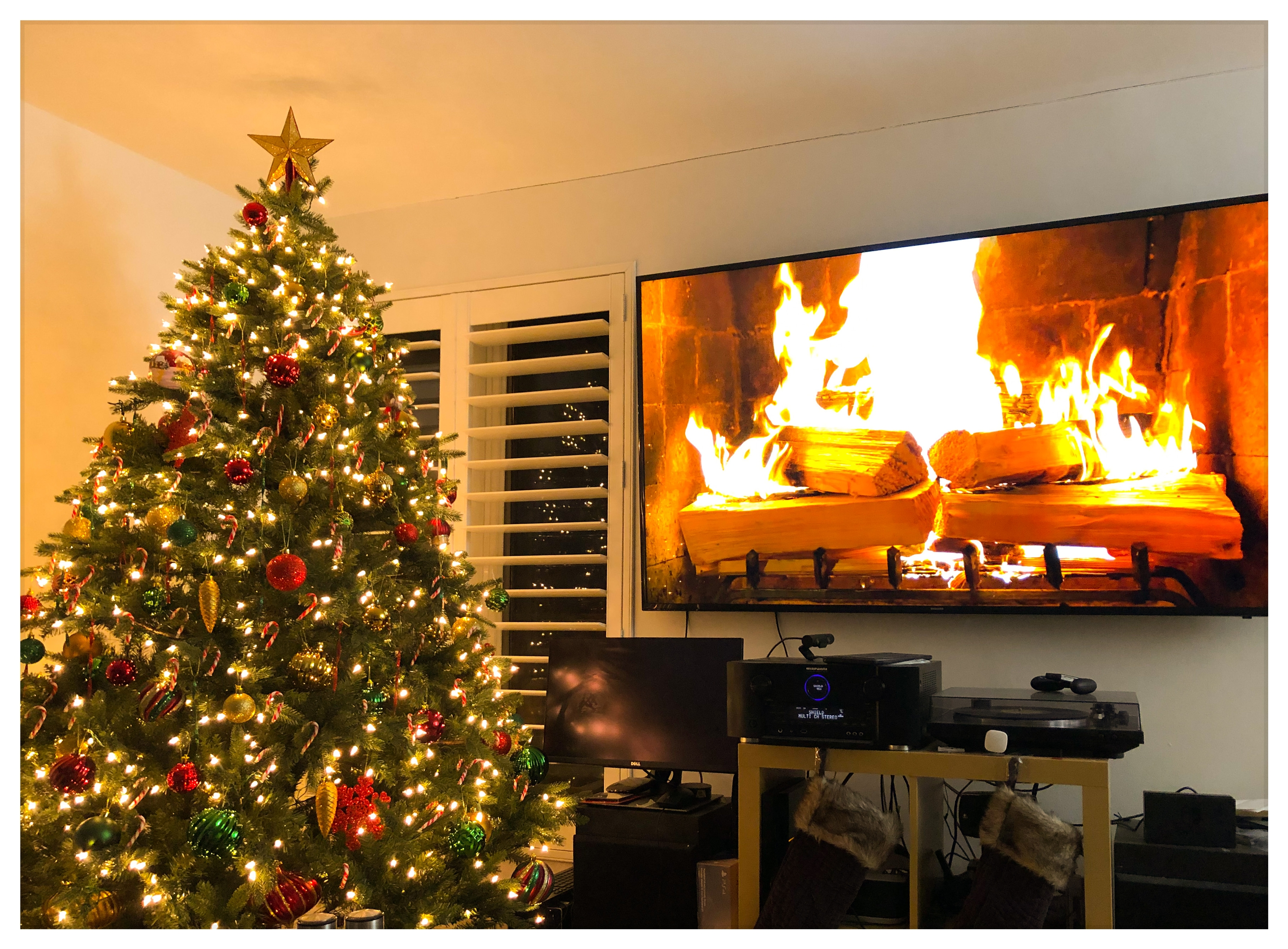 fully decorated and a 75 inch fire place