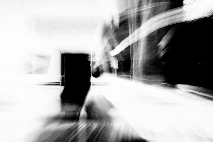 A black and white image shot by Jay Sennett of postal truck with a very blurry vortex achieved by pulling focus.