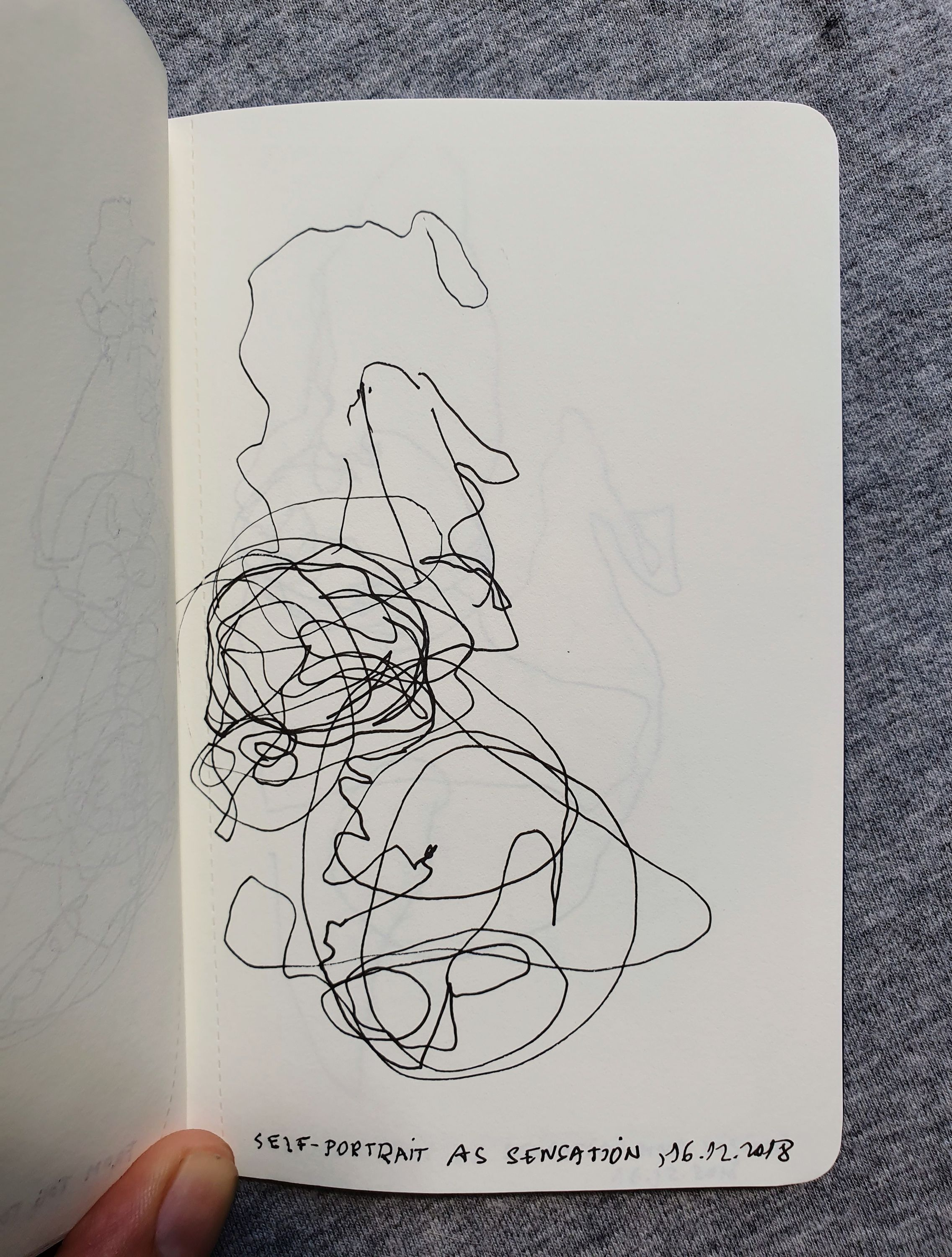 Drawing with Eyes Closed Notebook on Chest