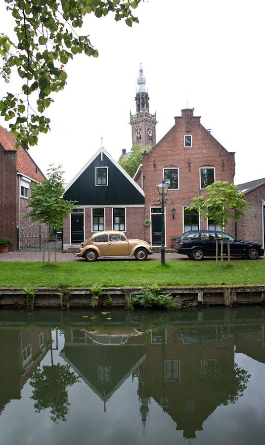Old houses, cars and canals in Edam