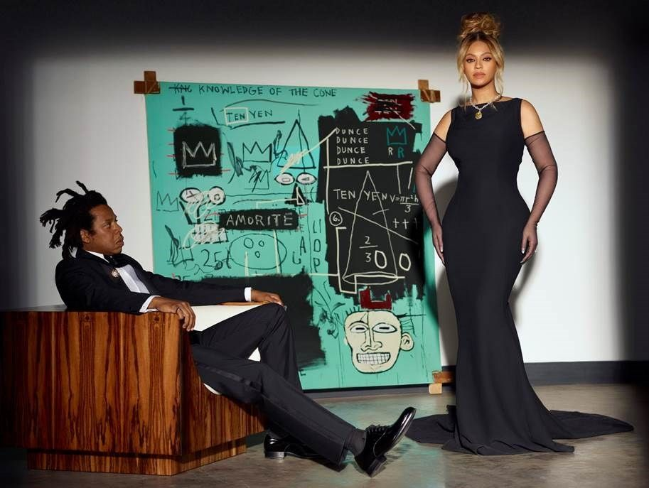 Jay-Z and Beyonce pose in front of Basuqiat's piece, Equals Pi, for a Tiffany advertisement