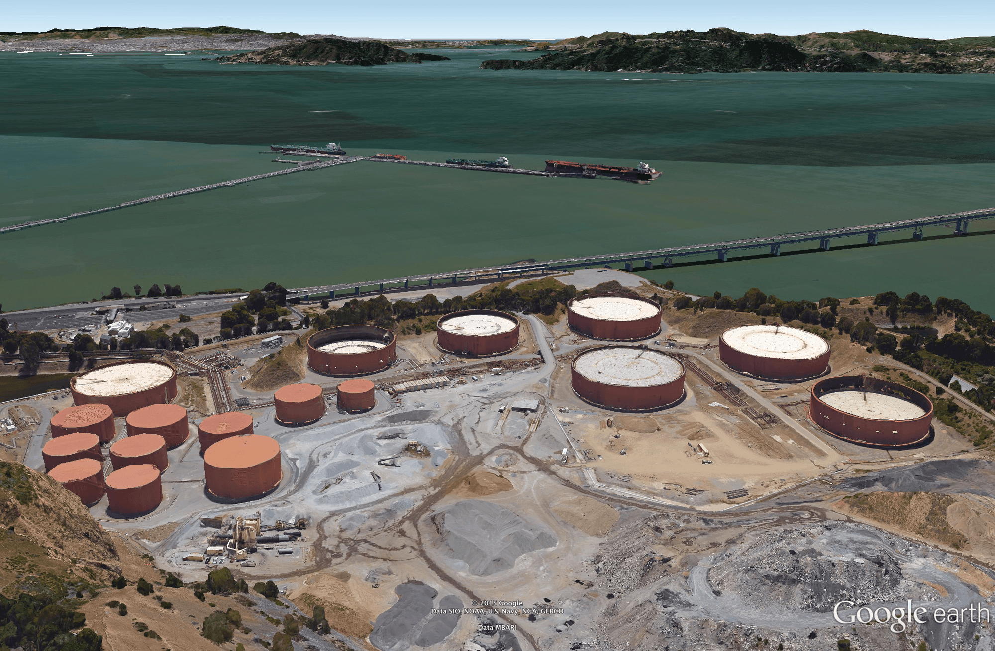 Section of the Chevron Richmond Refinery. These tanks are used to store crude oil offloaded from oil tankers. the tanks on the right are the ersatz 747 hangars.
