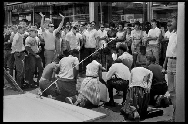 Demonstrators gather on a sidewalk under the taunts of whites on June 15, 1963. (Photo by Anthony Falletta)