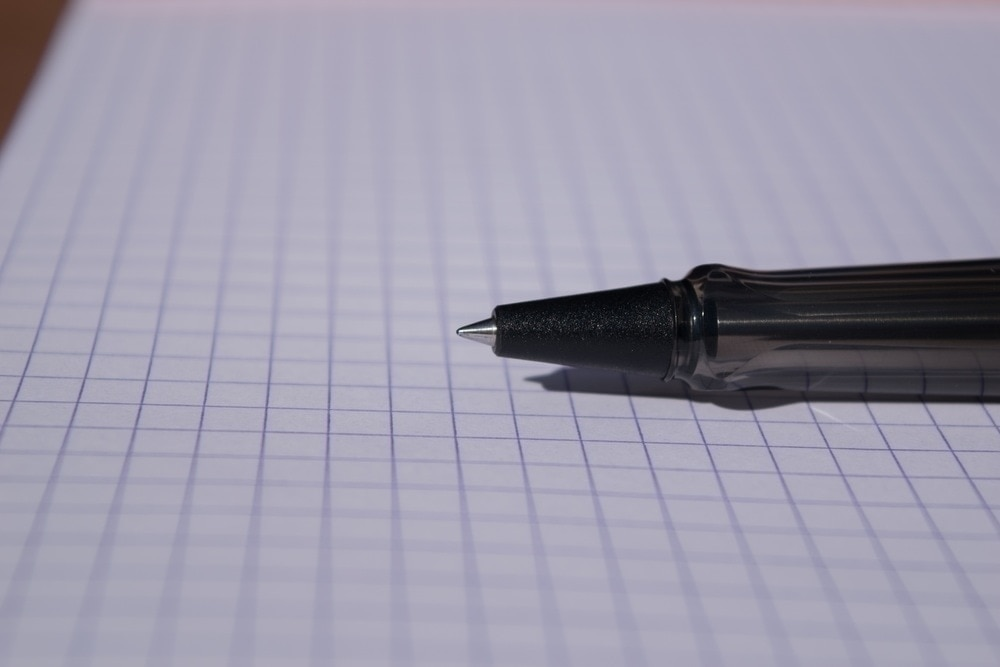 Lamy Al-Star with Mont Blanc rollerball refill. You can see in this picture how the tip doesn't stick out as far