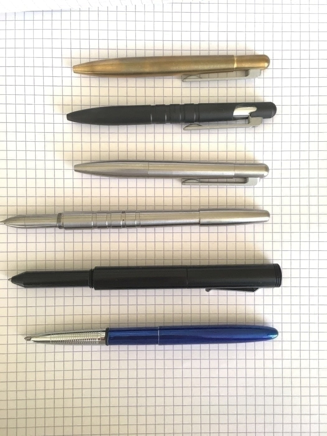 Top to Bottom: Brass Field Pen Compact, Field Pen, Stainless Field Pen Compact, Machine Era Co Pen, Schon DSGN Pen, Fisher Bullet
