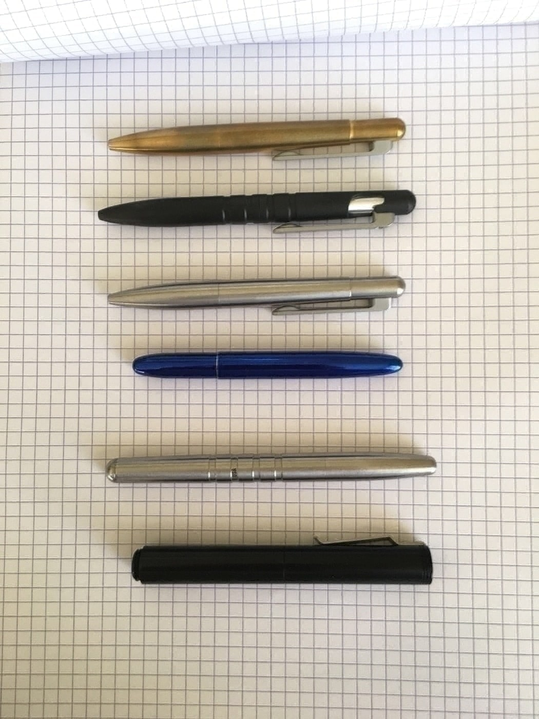Top to Bottom: Brass Field Pen Compact, Field Pen, Stainless Steel Field Pen Compact, Fisher Bullet, Machine Era Co Pen, Schon DSGN Pen