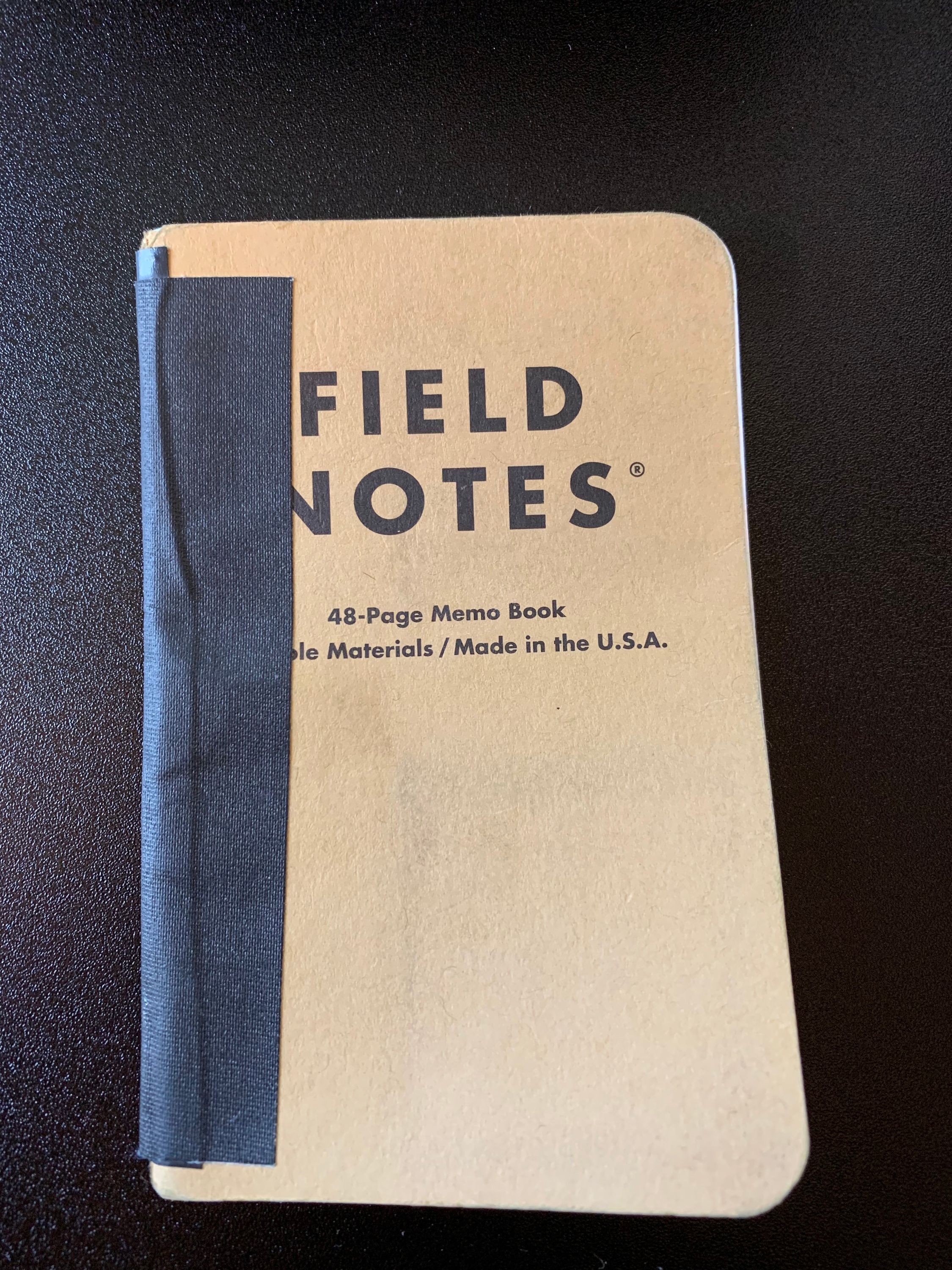Field Notes Held together by Electrical Tape