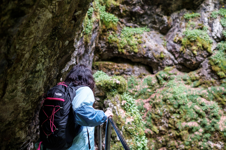 Navigating the metallic stairs descending into Scărișoara. Fujifilm X-Pro 2 + 23mm: 1/105 @ ƒ/2 ISO 400