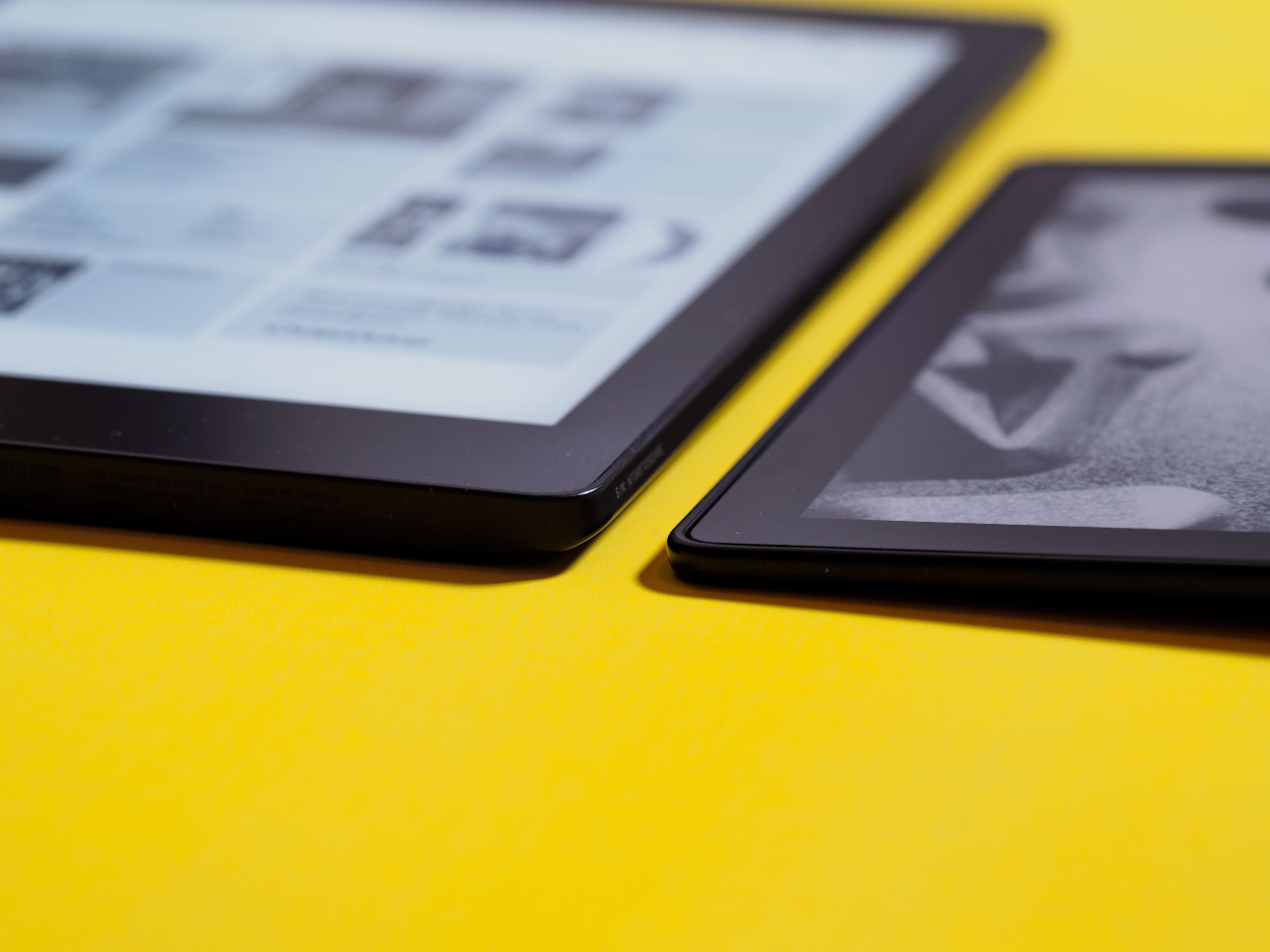 The Kindle Oasis (right) is not only significantly smaller in shape, it's also thinner along its tapered edge. The button side is about the same thickness as the Aura One (left).
