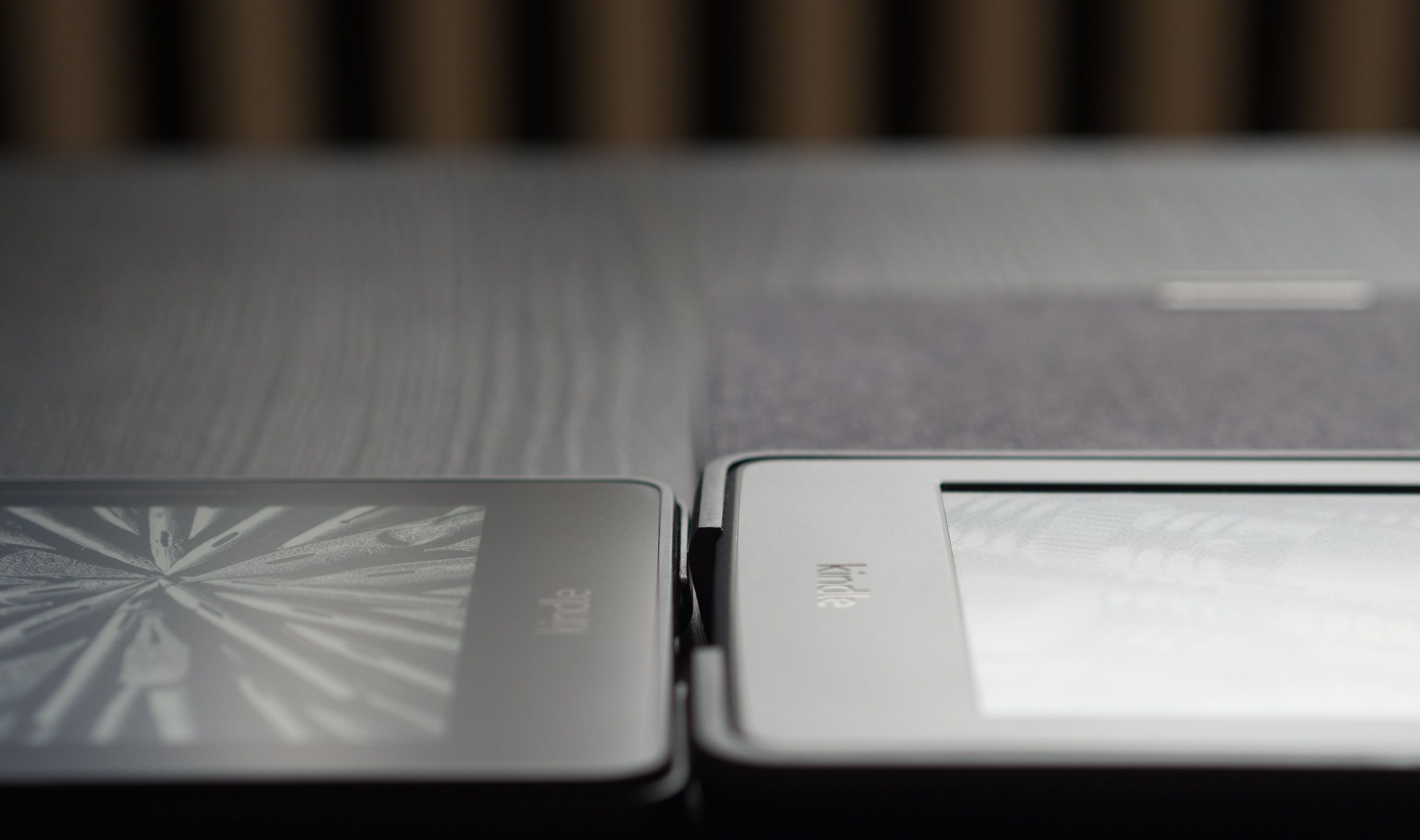 A side effect of this mechanism is that the case doesn't add as much bulk around the edges of the device, which gives the whole setup a more refined look than the chunky rubber corners of the Paperwhite cover (right).