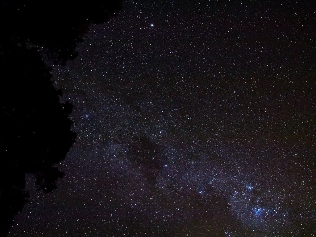 A picture of the night sky, with the Milky Way across it from the right corner and going up and to the left.