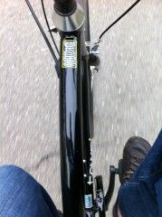 color photo of jay's feet on bike