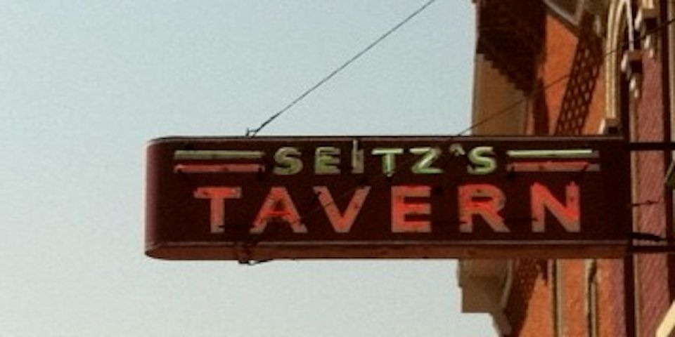 A color photo of the neon sign of Seitz's Tavern