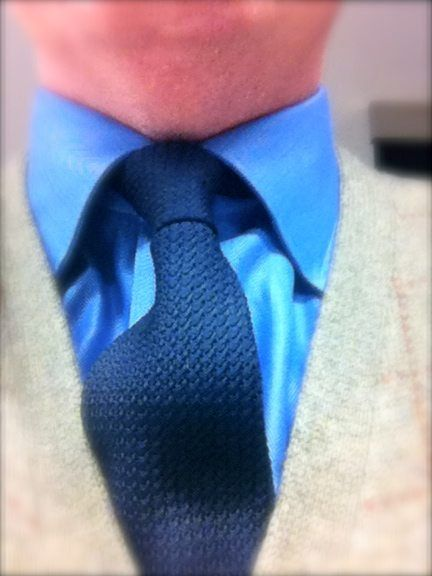 A color photo of Jay in a French blue shirt and grenadine tie