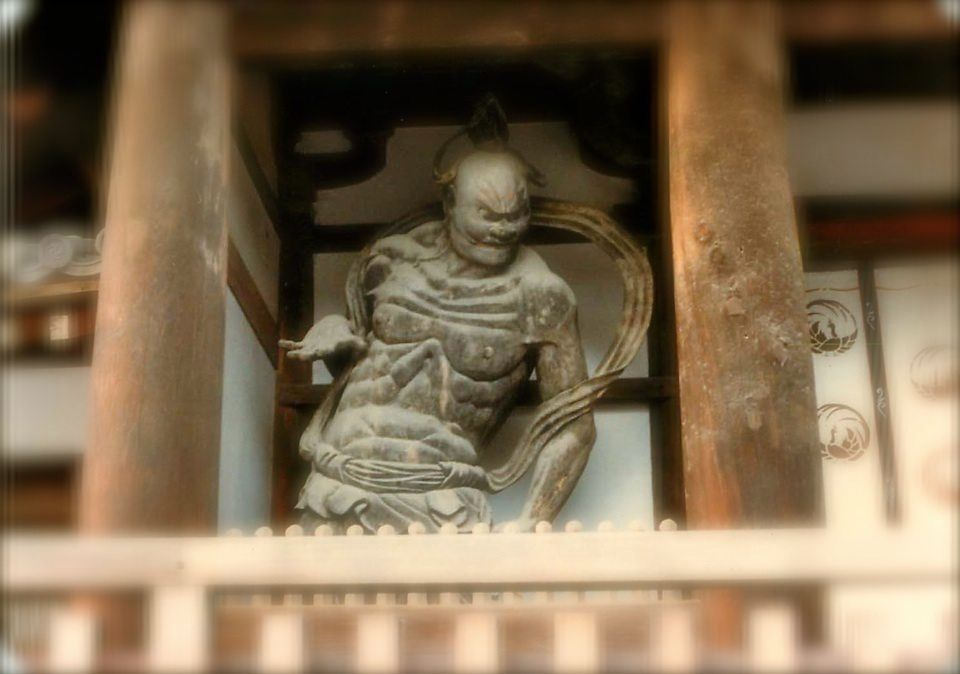 Photo of a devil outside a buddhist temple