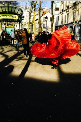 A woman dances with a red cape in Montmartre. Shot with an iPhone 6 by Jay Sennett