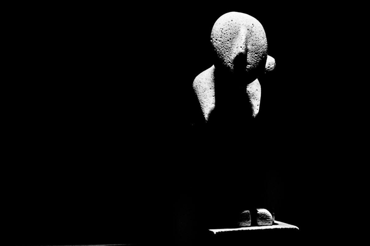 A statue sits bathed in light surrounded by darkness. Shot with a Canon 60D by Jay Sennett