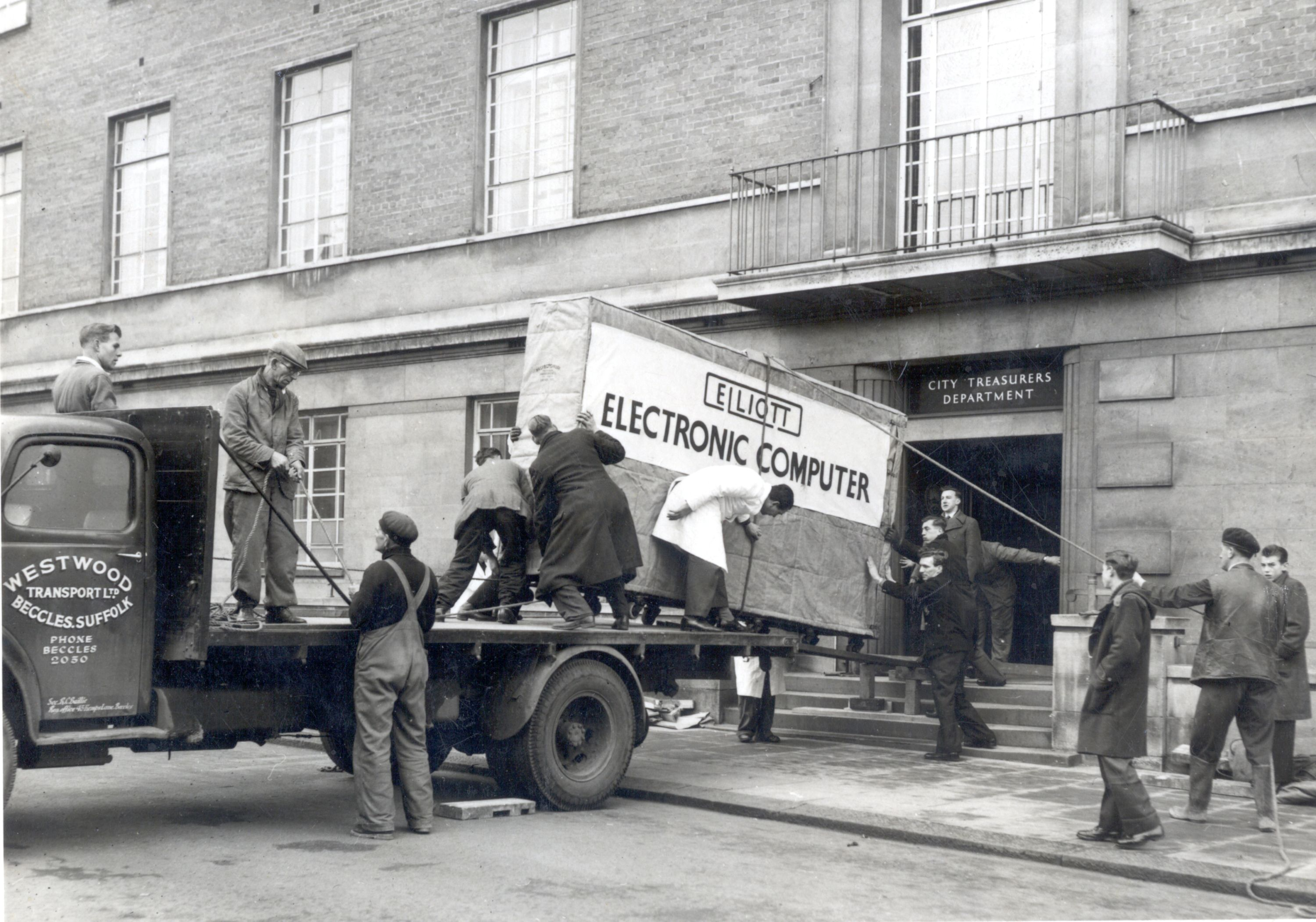 Photograph of Norwich City Council's first computer being delivered to the City Treasurer's Department in Bethel Street, Norwich, 1957. Norfolk Record Office: ACC 2005/170 (facsimile)