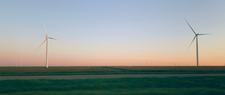 Some windmills in Texas near dusk