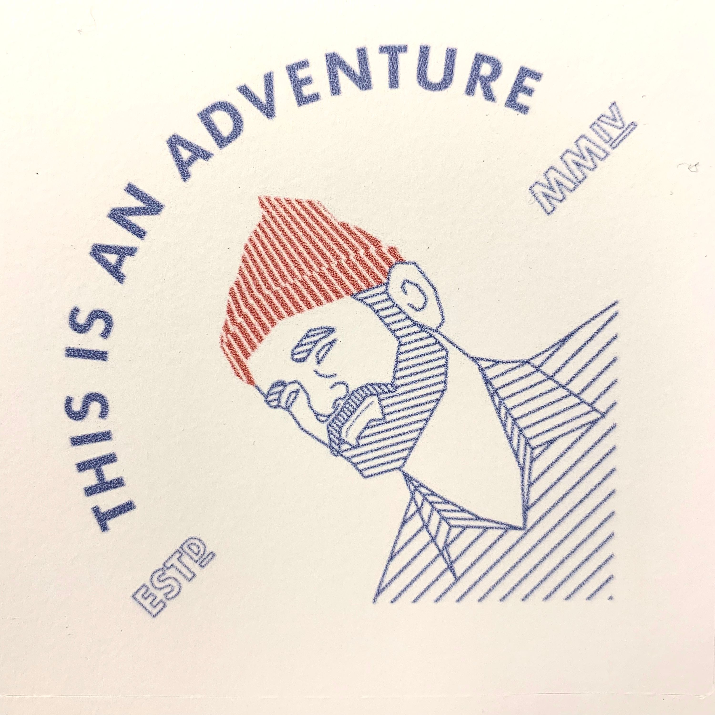 """A sticker with Steve Zissou's face and the words """"This is an adventure"""""""