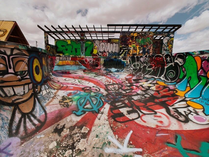 An empty skateable swimming pool covered with Graffiti in AZ