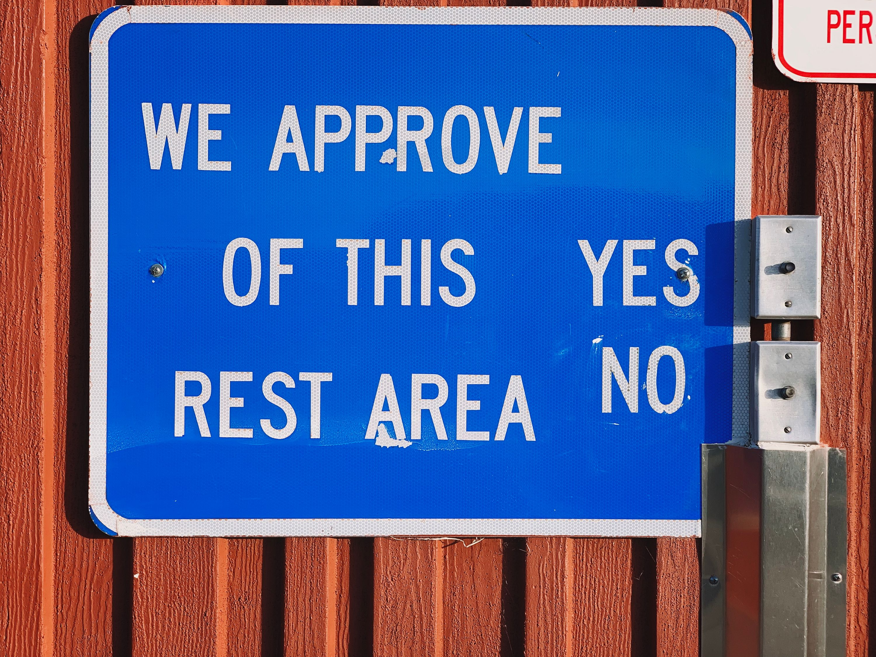 Traveler interaction with a sign requesting your approval at a rest area in Arizona