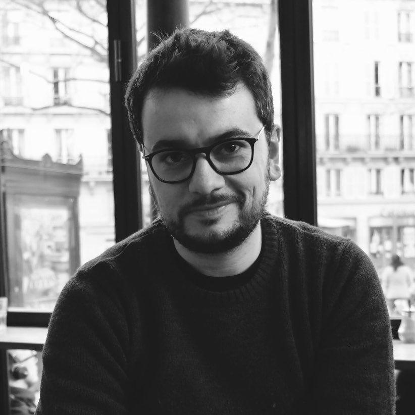 Medium shot black and white portrait of myself, Nicolas Magand, wearing glasses.