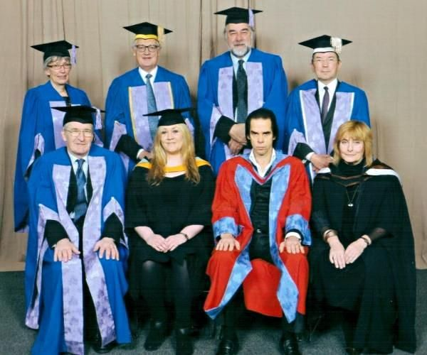 The singer songwriter Nick Cave sat with academics having received an Honorary Degree from Brighton University. He looks a little out of place.