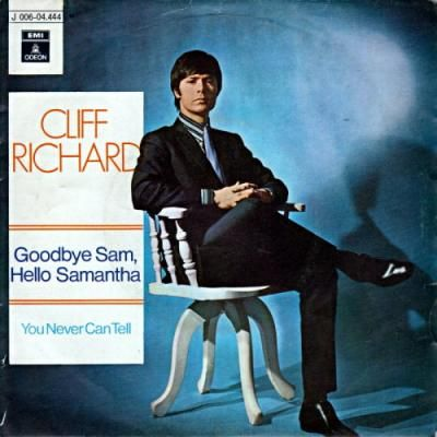 The picture sleeve of the Cliff Richard single Goodbye Sam Hello Samantha with him sat in a wooden chair