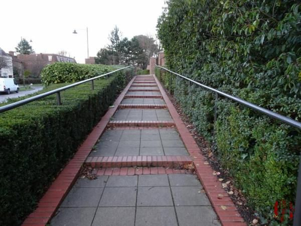 Sloping shallow steps of several feet in length.
