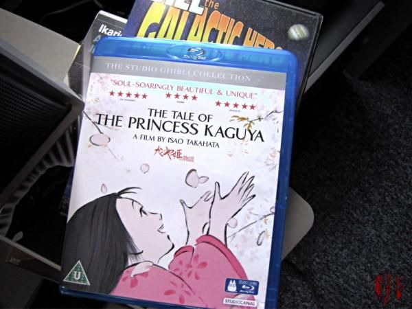 Photograph of the Princess Kaguya Blu Ray box showing the eponymous animated character delighted at the falling cherry blossom