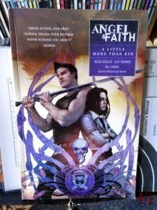 The cover of the Angel & Faith Comic Collection 'A Little More Than Kin' with the eponymous heros stood back to back, Angel resting a broadsword on his shoulder whilst faith is cross-armed.