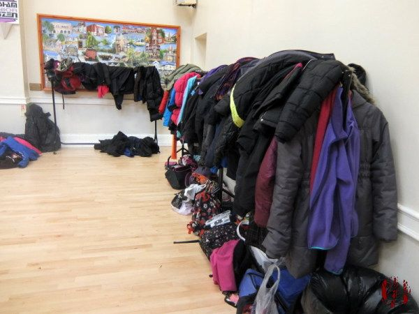 Clothes rails in the Drill Hall Horsham piled high with coats from school children attending Junior Citizen.