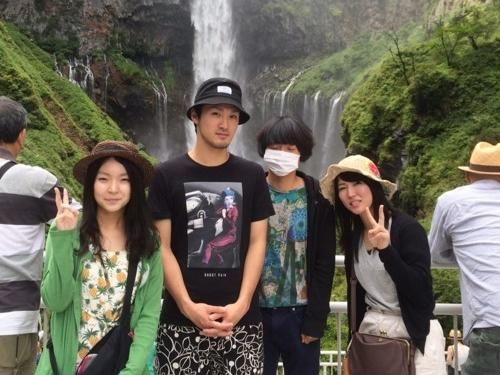 The Japanese band ハイスピード瞬き (High Speed Blink) stood in front of a waterfall, as you do