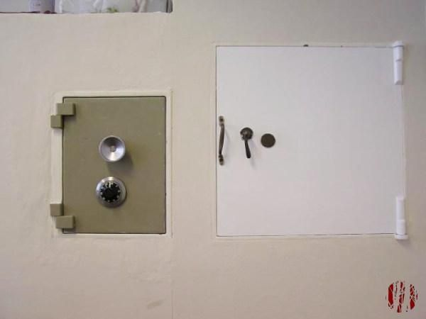A brace of safes, one with combination lock and the other key operated, concreted into a wall of a room at the Drill Hall.