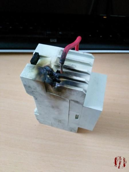 A burnt DIN mount electrical timer.