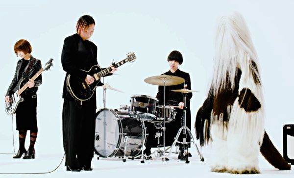 The two guitars bass and drums line up of 3/4 female Japanese band Tricot with their singers replaced by a a large hairy yeti like creature. They are also playing different instruments to usual.
