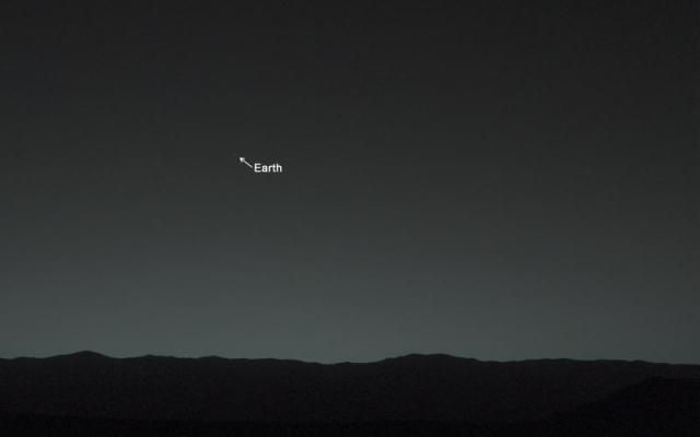 A caption and arrow indicate the earth in a photo of the sky from Mars.