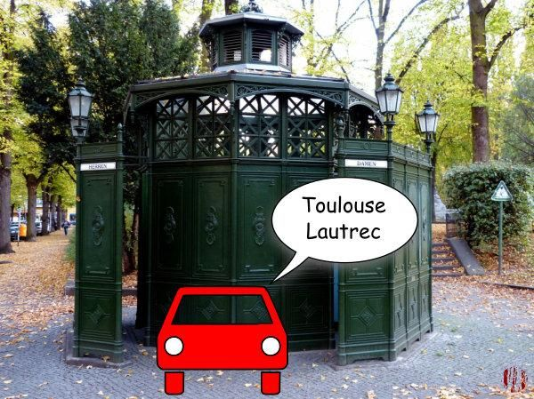 """A cartoon car in front of an old Berlin public toilet saying, """"Toulouse Lautrec""""."""