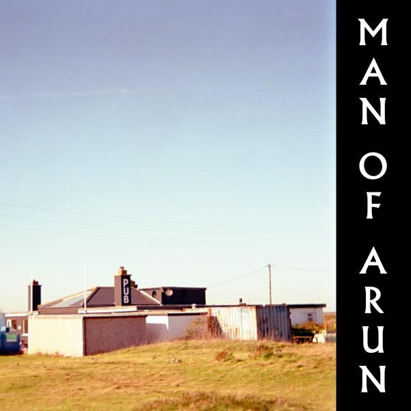 The front cover of the Man Of Arun EP with the name vertical on the right hand edge and a picture of a fairly modern yet dilapidated pub on the right taking up most of the area