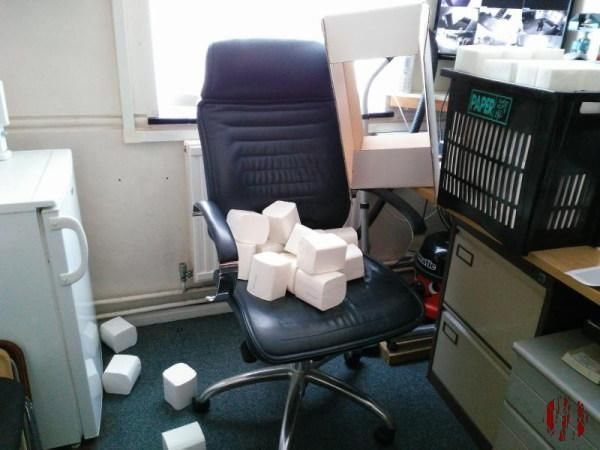 Toilet paper strewn across chair and floor.