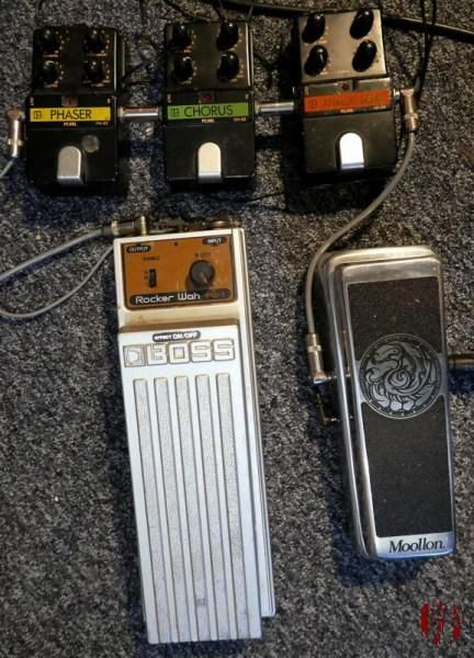 Pearl Chorus, Phaser, and delay pedals alongside a Moolon wah.