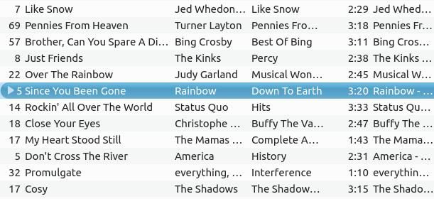 A randomly generated playlist with Judy Garland's version of Somewhere Over The Rainbow followed by Since You've Been Gone by the rock band Rainbow.