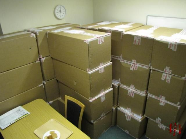 Large pile of cardboard boxes in an office about 2ft by 1ft by 1ft