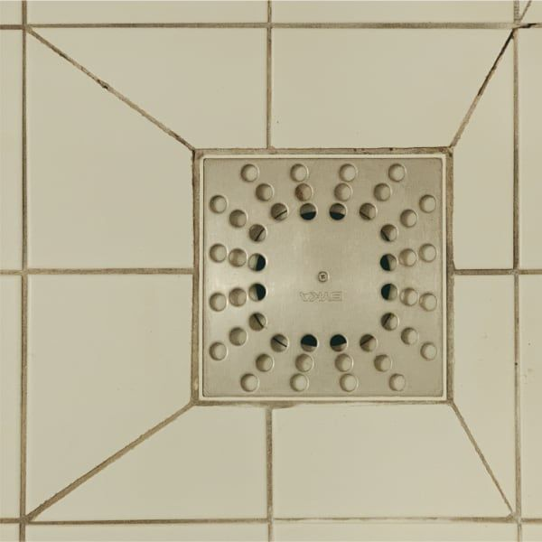 The misaligned bathroom drain