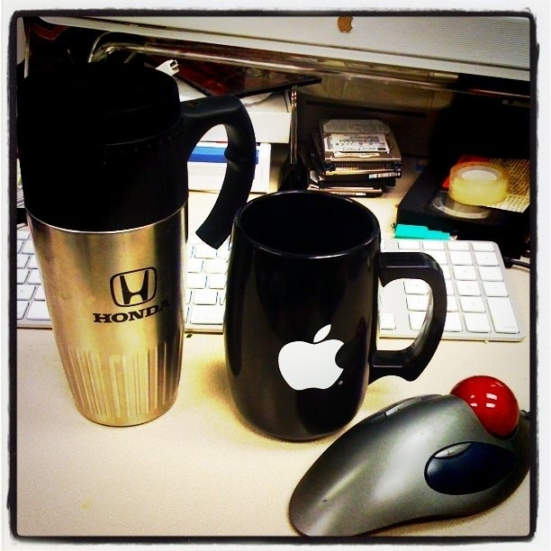 Honda mug, Apple cup, and mouse ball.