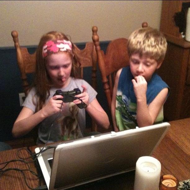 Kids gaming on a laptop