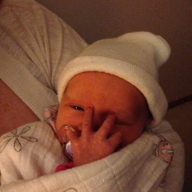 Baby Siena peeking through her tiny hand.