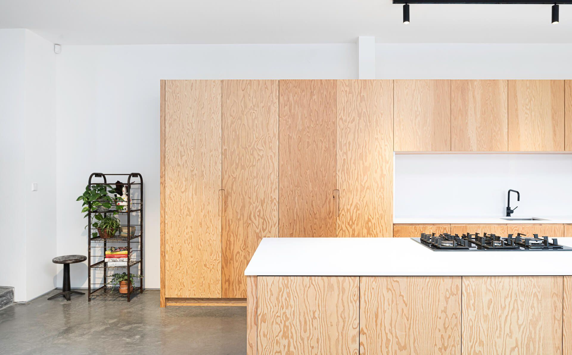 Douglas-Fir-Plywood-Kitchen-with-white-walls-and-polished-concrete-floor