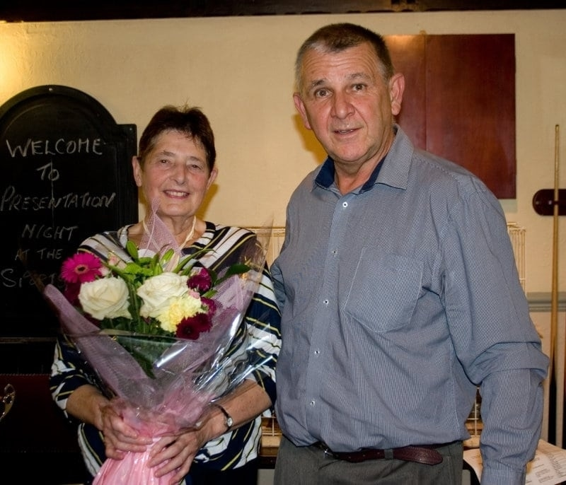 Mrs Gaskill receiving flowers from Bob McKie